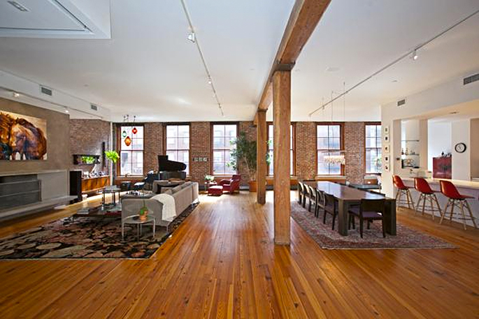 The original beams provide a natural room divider.