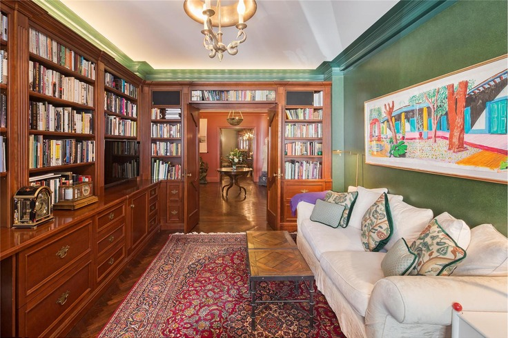 Fill the library's built in shelves with your favorite books
