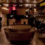 Bathtub Gin's trademark copper bathtub sits in the middle of the floor, ready to be used as a prop in Facebook photos.