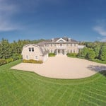 homes hamptons, famous homes for sale, tennis court hamptons, beach style furnishings, wrap around porch