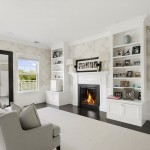 homes hamptons, famous homes for sale, tennis court hamptons, white living room, elegant fireplaces