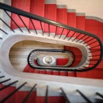 renovations chelsea, historic homes nyc, grand staircase, red stairwell
