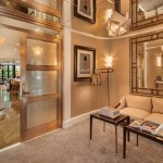 132 East 62nd Street, Suzanne Sheik, gold-plated couch and Frank Sinatra oil painting