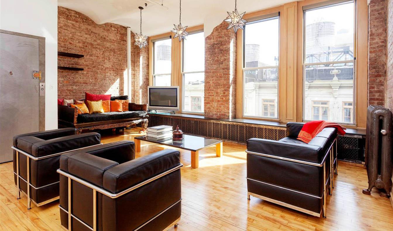 Soho loft mixes historic cast iron charm with for Soho interior design ideas