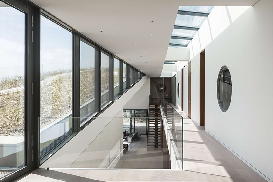 1100 Architect, sand dunes roof, Long Island House, glazed facade, natural light, minimal interiors, seaside home, slope roof, green roof,