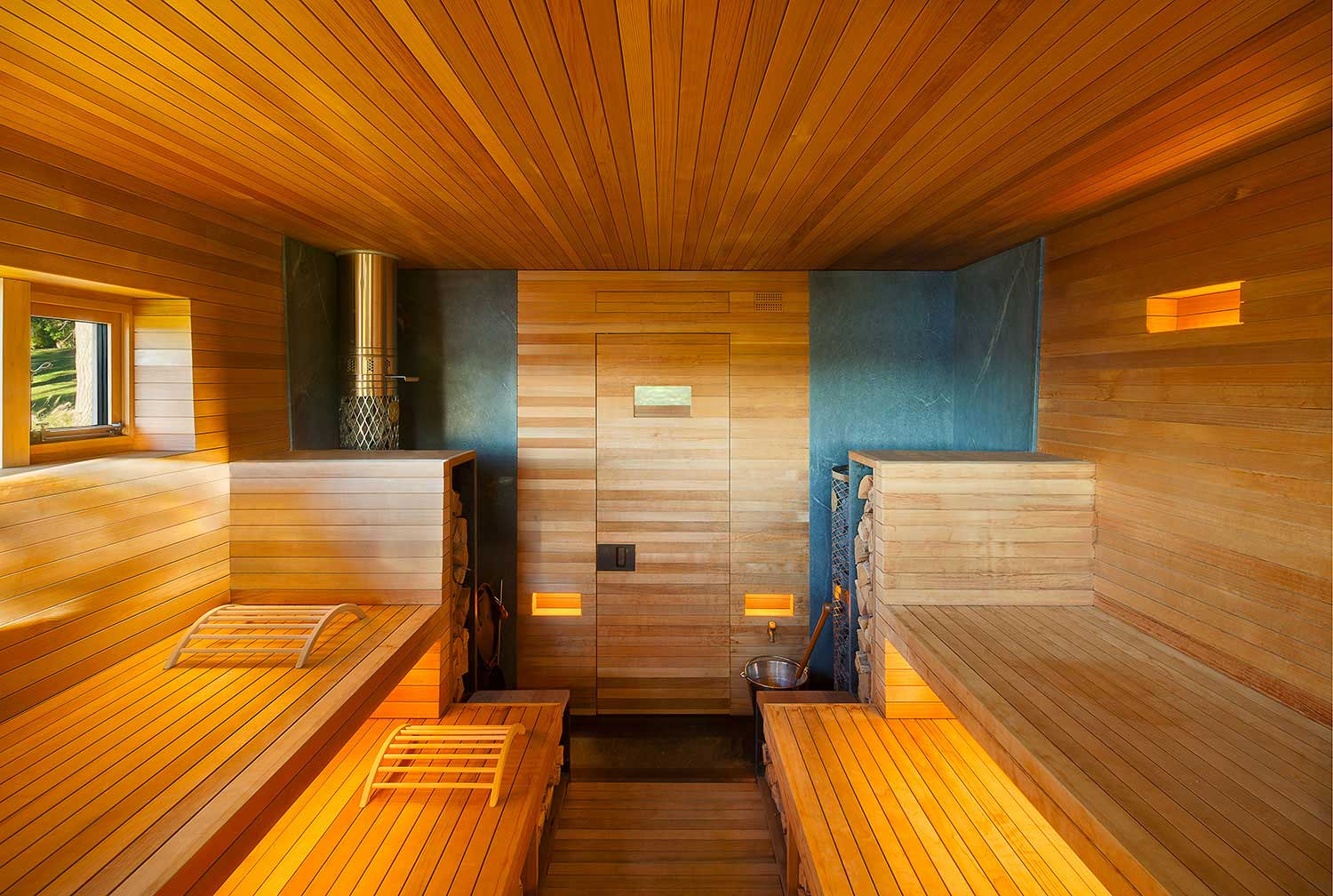 Wooden sauna welcomes guests to sweat out the stress of for Hudson valley interior design