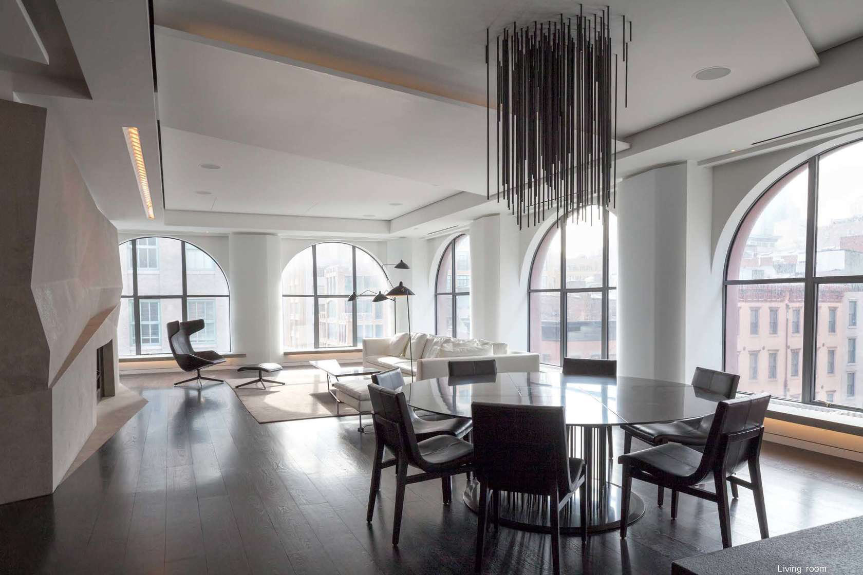 Sleek tribeca loft redesign features undulating walls and for Loft dining room ideas