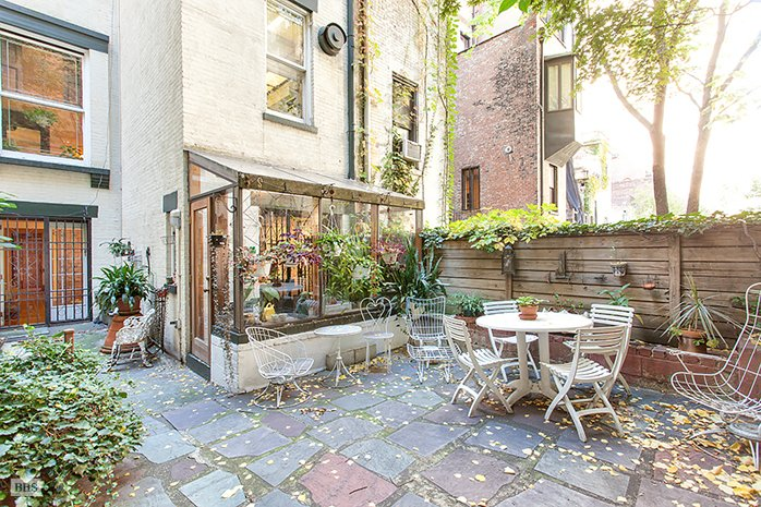 Wine making artists called this 6 8m uws townhouse home for Townhouse for sale in manhattan