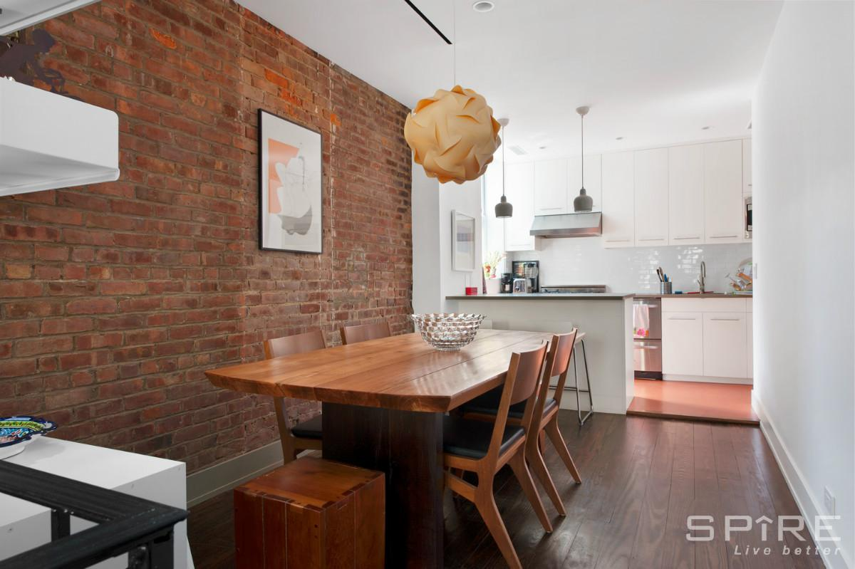 228 East 22nd Street, dining room, exposed brick, duplex rental