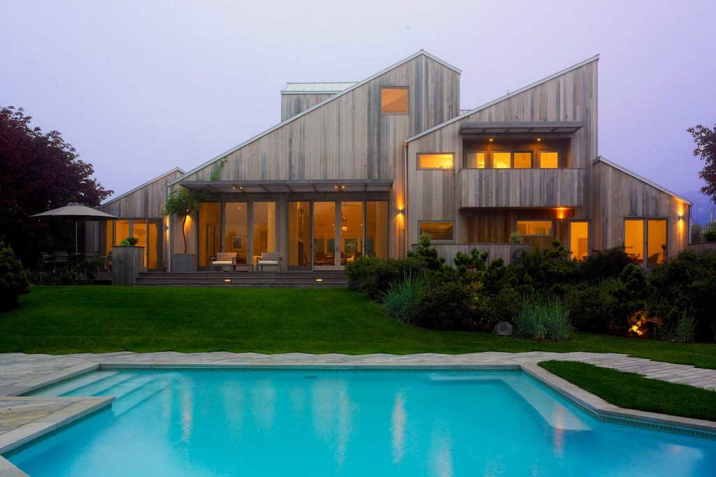 CCS Architecture, wood clad, Bridgehampton Residence, The Hamptons, multigenerational home, indoor/outdoor living, wooden deck, secluded entrance, eating al fresco, Cass Calder Smith founded, modernist home, house extension, house renovation