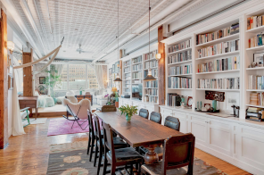 $2.4M Tribeca loft has a cool corner layout, arched windows, and amazing views