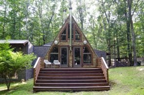 $400K cozy upstate A-frame puts a modern angle on a lakeside cottage retreat