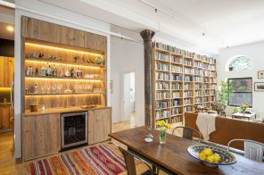Floor-to-ceiling bookshelves and a beautiful bar stand out at this $995K Boerum Hill co-op