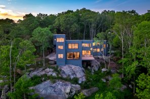 $2.8M contemporary Connecticut home sits on a granite outcropping overlooking the saltmarsh below