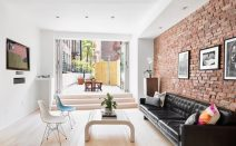 $2.3M railroad apartment on the Bowery boasts a 35-foot-long terrace