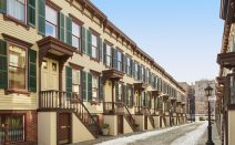 $1.6M Washington Heights row house is on a hidden historic street across from Manhattan's oldest home