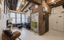 Bakery-turned-condo in Williamsburg holds an incredible apartment lined with exposed brick and beams